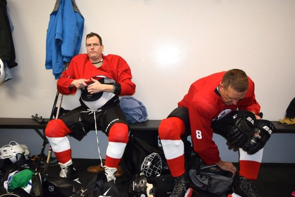 Blinded veterans Keith Haley and Jim Sadecki preparing to skate at the Saranac Lake Civic Center.  (Enterprise photo — Glynis Hart)