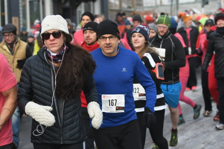 Runners begin their 5k run (or walk) in Saranac Lake Thursday morning during the Third Annual Bitters and Bones Turkey Trot. This year, the Thanksgiving Day event drew more than 300 participants. (Enterprise photo — Lou Reuter)
