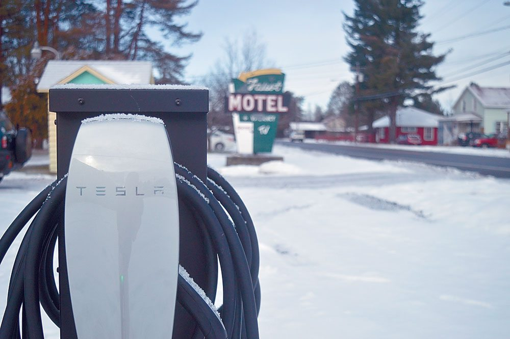 Two Tesla chargers and one universal electric vehicle charger were installed Nov. 21 at the Faust Motel in Tupper Lake next to Raquette River Brewing. Brewery co-owner Mark Jessie has bought the motel with plans to renovate and reopen it. He said on Facebook that the chargers will be available for free use by the public. (Enterprise photo — Aaron Cerbone)