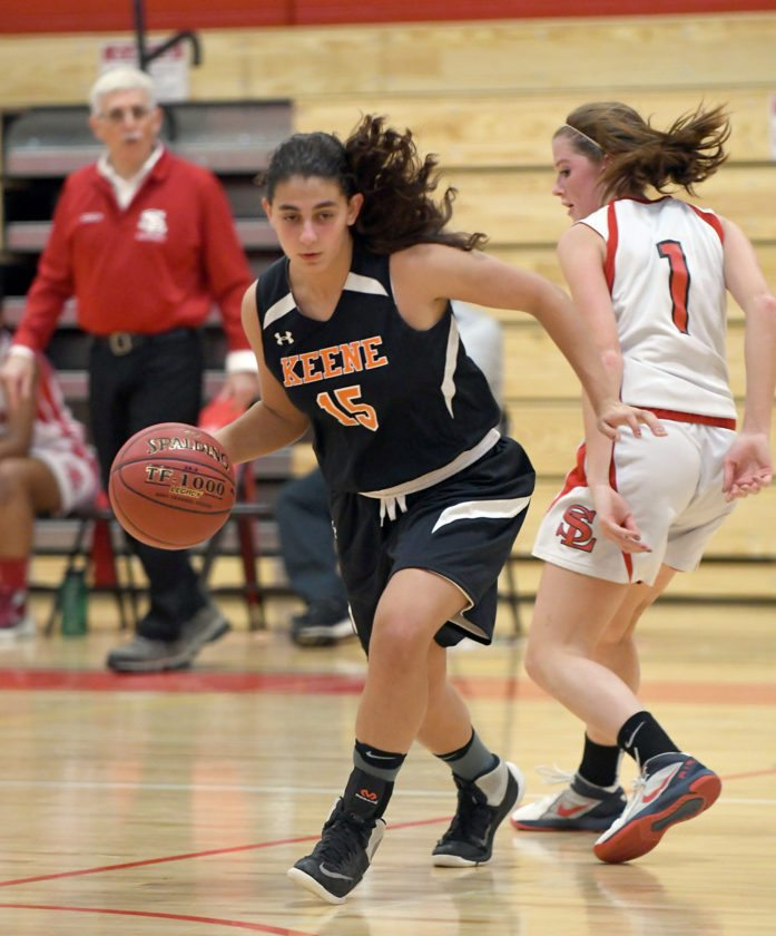 Keene's Alyssa Summo dribbles past Saranac Lake's Kylee Clark during the second half of Monday's game at Saranac Lake High School. (Enterprise photo — Lou Reuter)