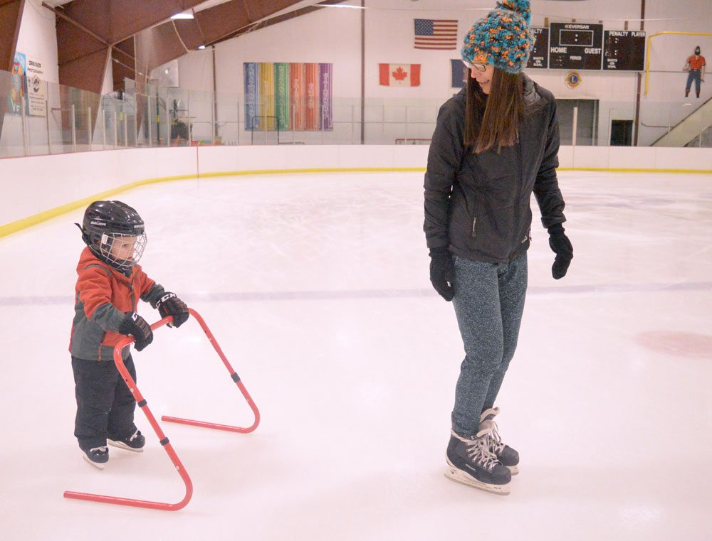 Brittany Willett teaches 3-year-old Cooper Willett how to balance on skates on his sixth time on the ice since the rink opened for the season Oct. 18 after major renovations over the summer. (Enterprise photo — Aaron Cerbone)