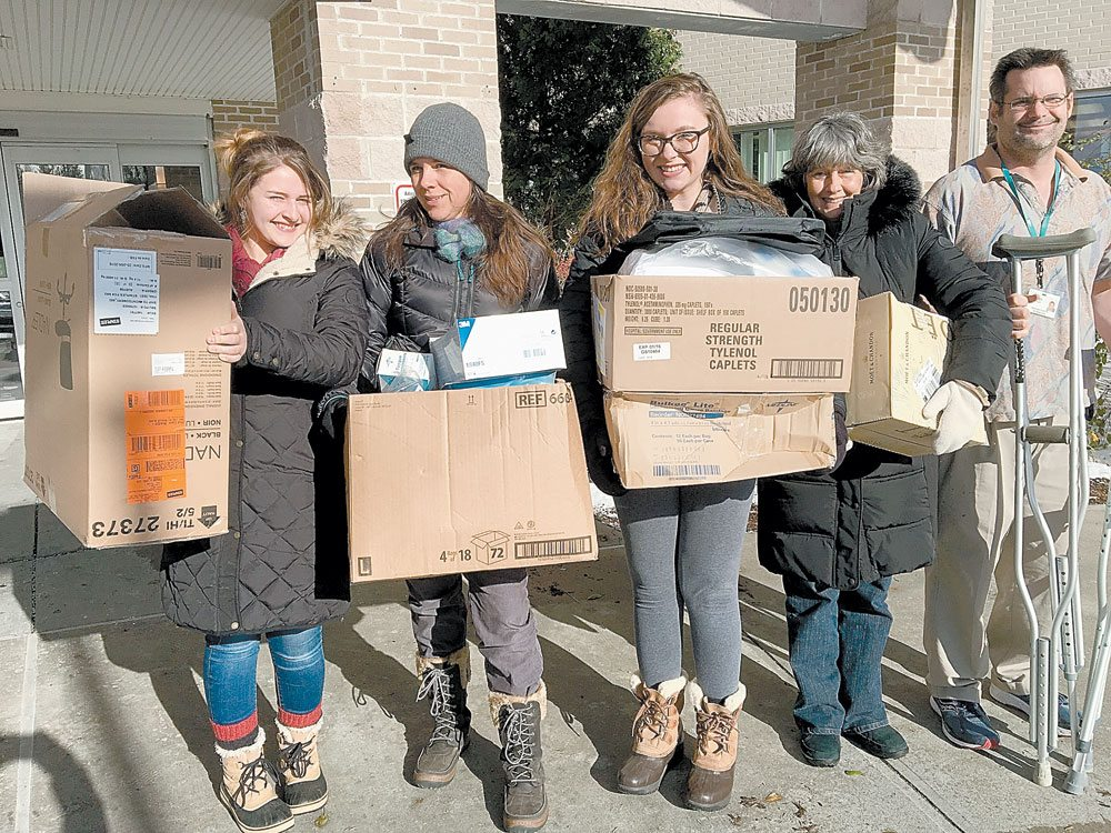 North Country Community College nursing students, from left, Megan Davis of Saranac Lake, Emily Sorensen of Richmond, Virginia, and Adriania Fanelli of Morristown and their clinical instructor Lori Bennett drop off medical supplies for the North Country Mission of Hope at Adirondack Medical Center in Saranac Lake with Jerry Stewart, a rehabilitation technician with Adirondack Health. (Photo provided by North Country Community College)