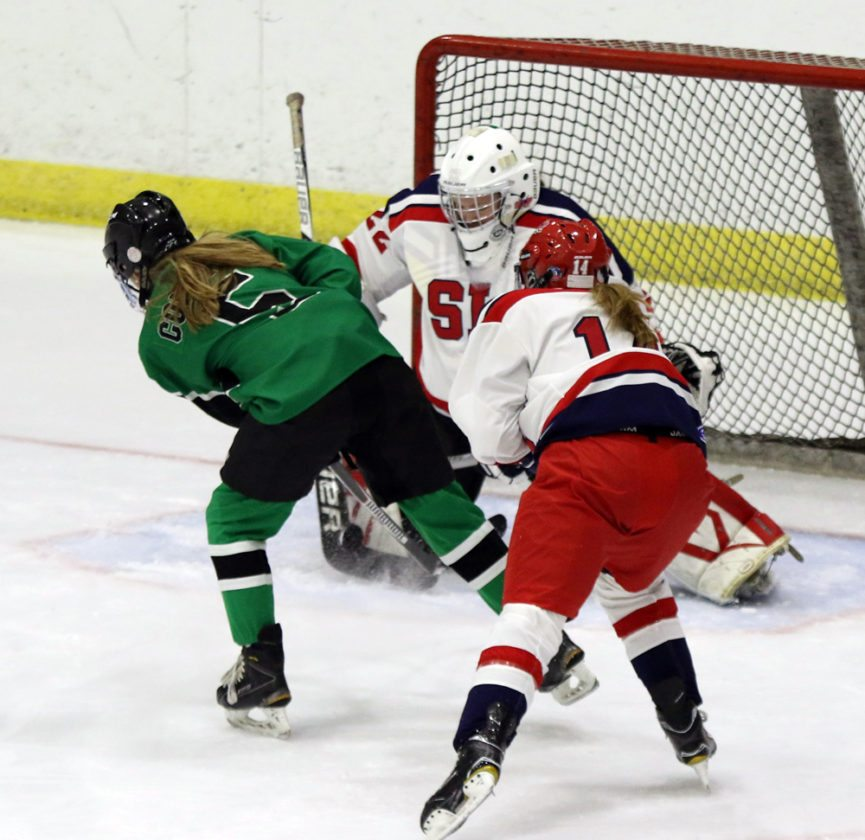 SLP goaltender Whirtney Battistoni makes a save as teammate Rylee Preston defends during Wednesday's game against Salmon River at the Olympic Center. (Provided photo — Alicia Brandes)