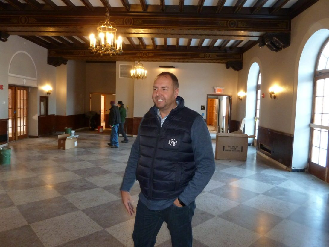 Hotel Saranac General Manager Michael Salyers stands in the Great Hall on the hotel's second floor Tuesday. (Enterprise photo — Peter Crowley)