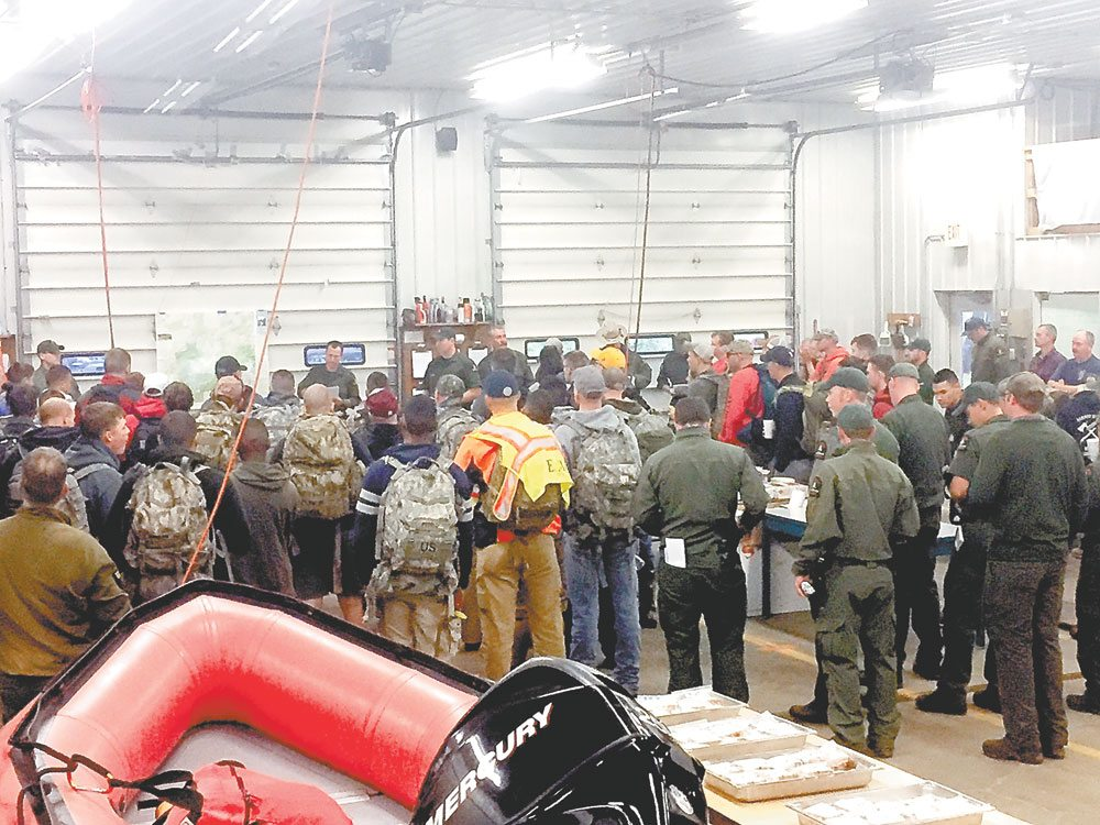 Forest rangers and volunteers conduct a briefing before heading out to search for a missing Fort Drum soldier on St. Regis Mountain in September. The union that represents rangers has been pushing the state to hire more of them in response to the state adding more than a million acres of land to the Adirondack Park in the last few decades. (Photo provided by NYS DEC)