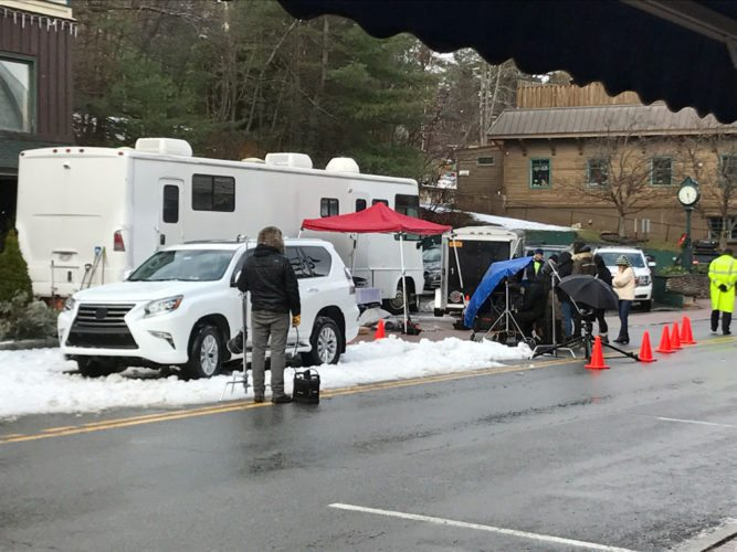 A snow tire commercial is shot on Main Street in downtown Lake Placid Wednesday. (Enterprise photo — Lindsay Munn)