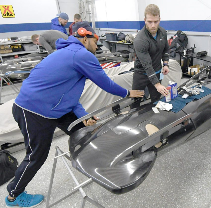Ryan Bailey, left, and Sam Michener work on a Team USA sled Wednesday, Nov. 8 at the Olympic Sliding Complex at Mount Van Hoevenberg in preparation for the opening World Cup event of the season. Bailey teamed with Nick Cunningham on Thursday, Nov. 9 to win a silver medal in the two-man competition in Lake Placid. (Enterprise file photo — Lou Reuter)
