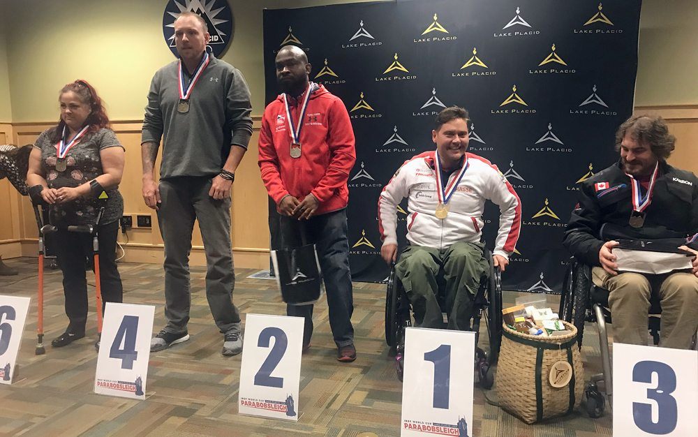 From left, Dawn Macomber, Barry Schroeder, Corie Map, Christopher Stewart and Lonnie Bissonnette receive awards after placing in Friday's Para Boblsed World Cup race held at Mount Van Hoevenberg. (Provided photo — Kristen Gowdy)