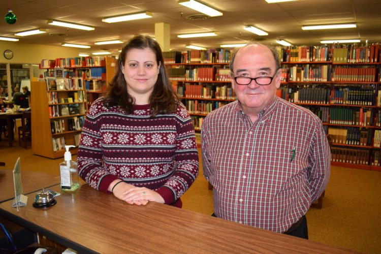 North Country Community College Director of Library Services Brian O'Connor, right, and Senior Library Clerk Brooke McCormick are ready to help local residents who'd like to use the Saranac Lake campus library. (Photo provided by NCCC)