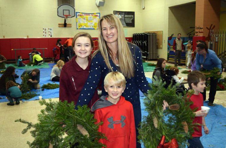 Erika, Sabine and Emmerich Denkenberger put together a wreath at the Petrova Elementary School wreath-making assembly held Monday.  (Photo provided — Katie Laba)
