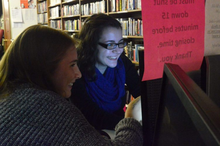 Twelfth-grader Emily Burns and 11th-grader Kirsten Denis are two of the 17 students in TupperLake's National Honor Society who will be offering technology assistance at the Goff-Nelson Memorial Library every Wednesday. (Enterprise photo — Aaron Cerbone)
