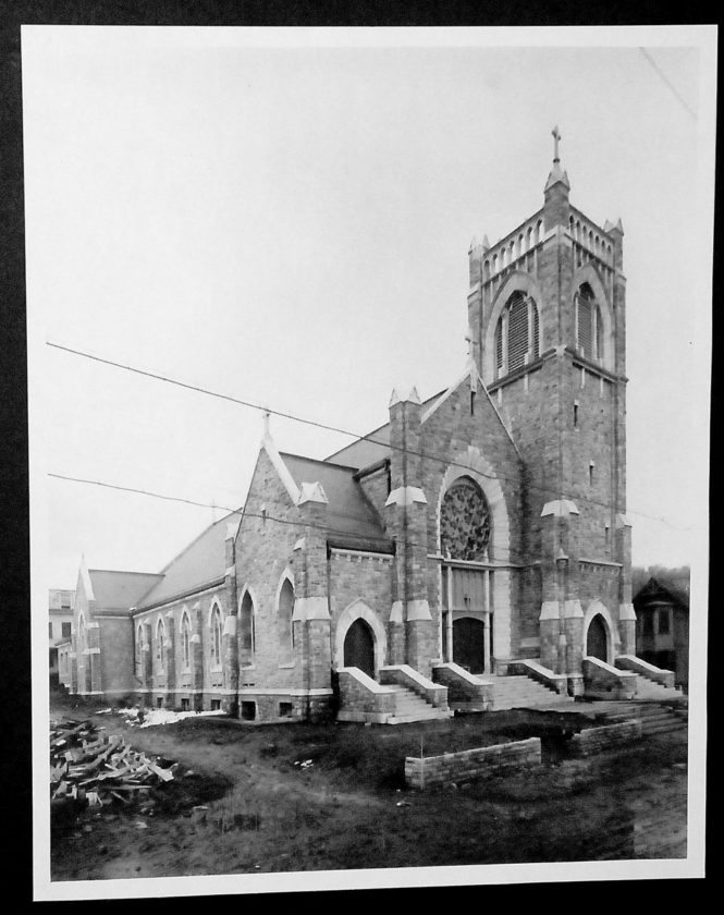 After a wooden church burned in 1909, the parish decided rebuilding with stone would be safer. (Photo from the Saranac Lake Free Library's Adirondack Research Room)