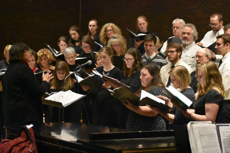 Conductor Helen Demong, front left, and the Northern Lights choir practice for their Winter Concert at 8 p.m. Friday at St. Bernard's Church at 27 St. Bernard St., Saranac Lake. (Enterprise photo — Griffin Kelly)