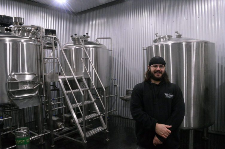 Big Tupper Brewing's head brewer Rickey LaFlamme stands in front of the pub's new brewing system where he will start brewing strong and creative beers next year. (Enterprise photo — Aaron Cerbone)