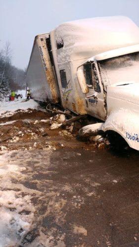 A Swift tractor-trailer is crashed into the roadside along state Route 30 near Blue Jay Campsite outside of Tupper Lake this morning. Tupper Lake Volunteer Fire Department members remain on scene this morning.  (Photo provided by the Tupper Lake Volunteer Fire Department)