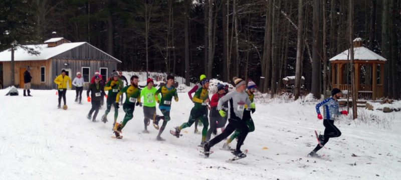 A field of 19 takes off at the start of the Jingle Bell 5K snowshoe race at the Paul Smith's College VIC on Saturday. (Photo provided)