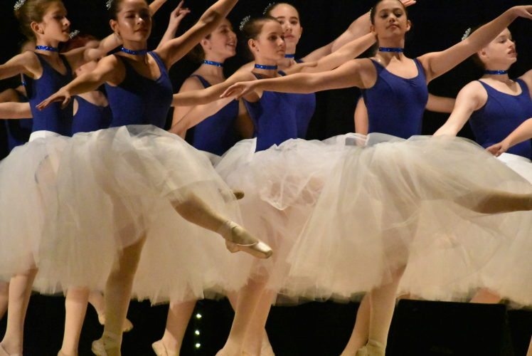 "Lea Kidd, left front, and Ruby Maiore, right front, along with the rest of their dance group, perform a ballet set to ""Silent Night"" at Dance Sanctuary's show last night at the Harrietstown Town Hall in Saranac Lake. (Enterprise photo — Griffin Kelly)"