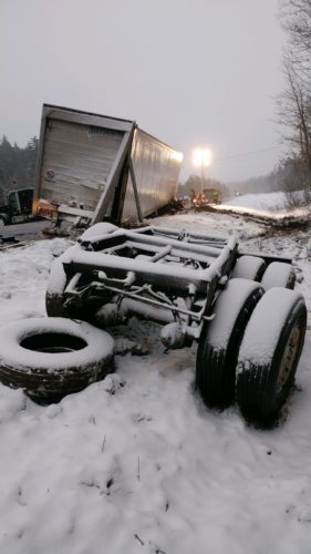 The Swift Transportation tractor-trailer that spilled 200 gallons of diesel fuel sits in the mud off state Route 30. The state Department of Environmental Conservation will continue to mitigate the impact to a nearby wetlands complex throughout the week. (Photo provided by the Tupper Lake Volunteer Fire Department)