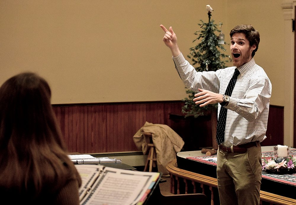 Drew Benware practices singing scales with the Northern Adirondack Vocal Ensemble.   (Enterprise photo — Griffin Kelly)