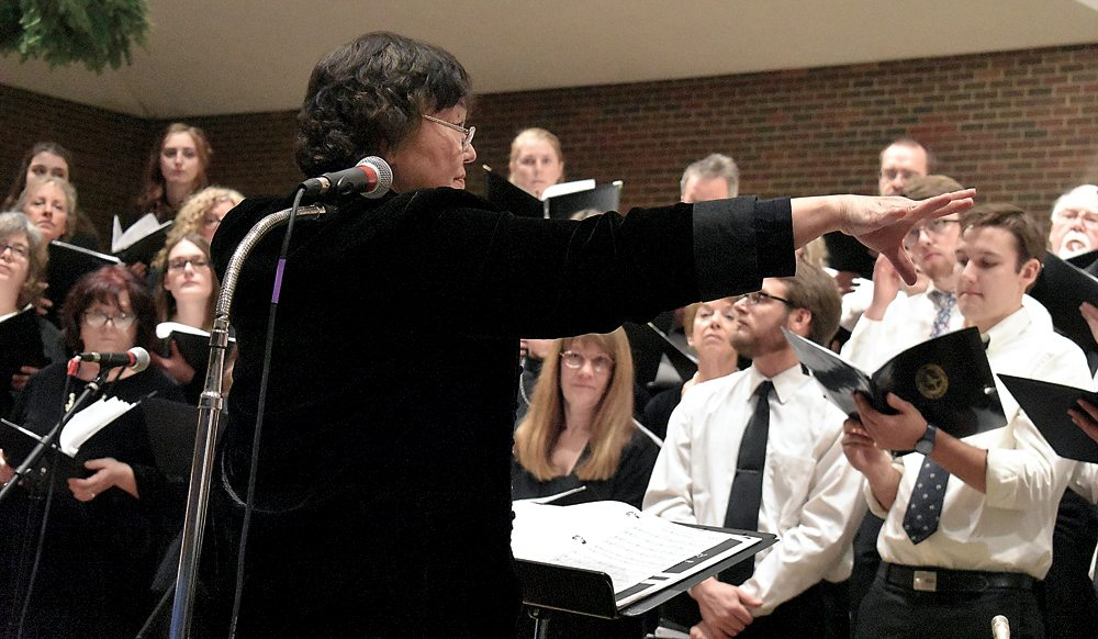 Helen Demong conducts the Northern Lights Choir during their winter concert Friday, Dec. 8 at St. Bernard's Church in Saranac Lake.  (Enterprise photo — Griffin Kelly)