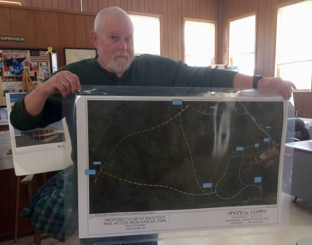 Town of Franklin Supervisor Art Willman holds up the map of proposed Kate Mountain trails at the town hall Monday in Vermontville. (Enterprise photo — Justin A. Levine)