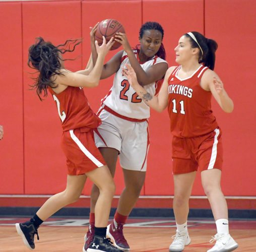 Mistre Newton of Saranac Lake rips the ball away from Moriah's Makayla Stockwell to secure a rebound during Thursday's game in Saranac Lake. Also pictured for the Vikings is Kaylee Orr. (Enterprise photo — Lou Reuter)