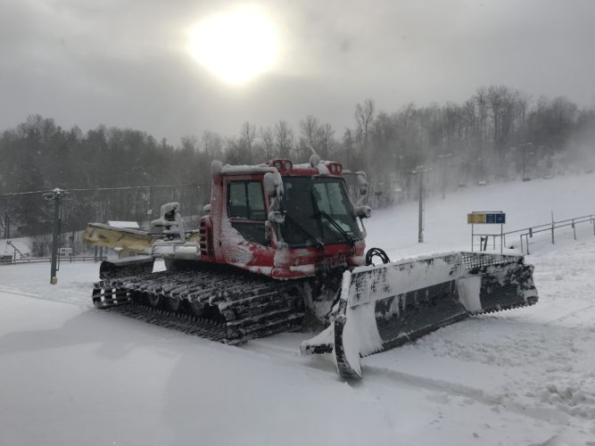 A groomer makes its way across the slopes at Titus Mountain in Malone. The mountain will open for night skiing tonight. (Photo provided)