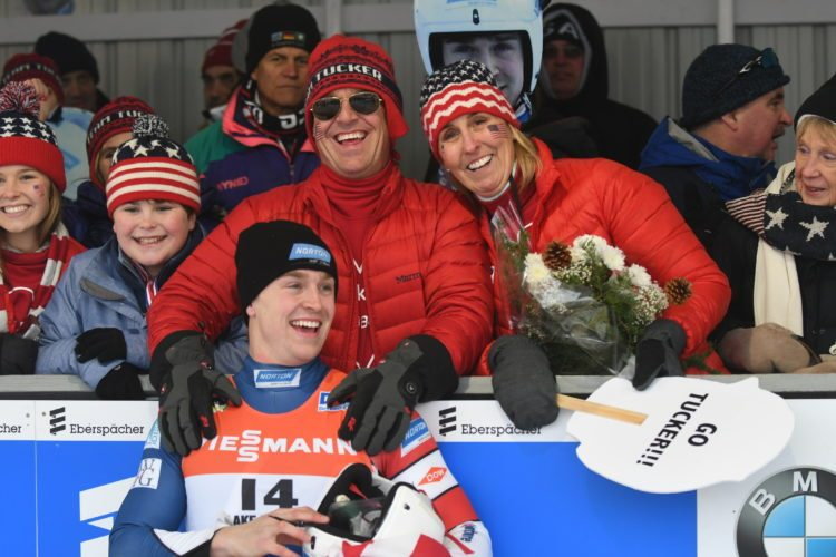 United States luge athlete Tucker West shares smiles with his mother Pam and father Brett after the 22-year-old captured the bronze medal Friday in men's singles on the first day of World Cup racing at Mount Van Hoevenberg. The World Cup action wraps up in Lake Placid today with women's singles and the sprint competitions. It was announced Friday that West will join the men's team headed to Pyeongchang for the Olympics. (Enterprise photo — Lou Reuter)