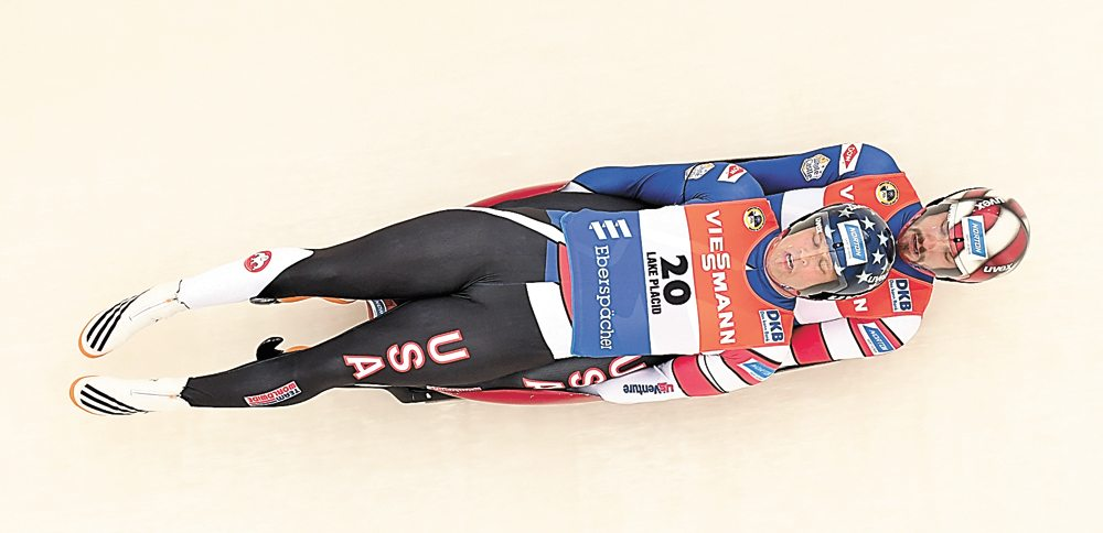 Matt Mortensen, in front, and Jayson Terdiman navigate curve 17 at Mount Van Hoevenberg during Friday's World Cup luge doubles race. The pair set a new track record on the run, but the mark was short-lived as the Americans ultimately finished fifth in the competition. (Enterprise photo — Lou Reuter)