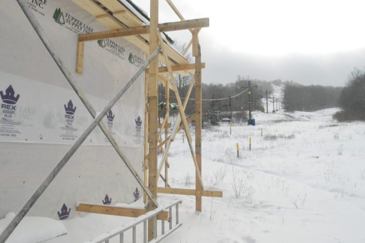 Chair 2 will carry skiers and snowboarders up Big Tupper Mountain once again in 2018, according to  Adirondack Club and Resort developers and caretakers. Construction, including the addition of a new metal roof, will be finished on the chair lift enclosure in the spring. (Enterprise photo — Aaron Cerbone)