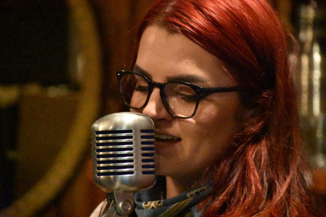 """Emily Mitchell performs Saturday at Raquette River Brewing in Tupper Lake at an album release party for her solo record, """"Retrospect."""" (Enterprise photo — Griffin Kelly)"""