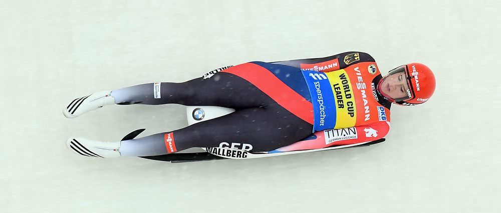 Natalie Geisenberger glides through the 17th curve during the first of two women's singles runs in Saturday's World Cup. The German won the race. (Enterprise photo — Lou Reuter)