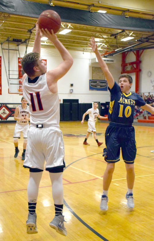 Lumberjack sophomore Jacob Stradley takes a shot from the left side as Madrid-Waddington's Evan Ruddy throws up a hand. (Enterprise photo — Justin A. Levine)