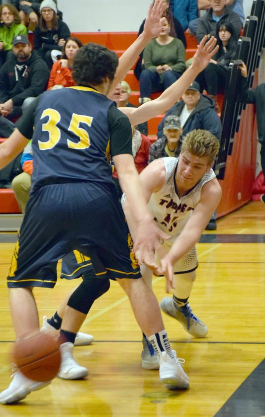 Jacob Stradley feeds the ball under the basket to a Tupper Lake teammate after grabbing an offensive rebound late in the second quarter. (Enterprise photo — Justin A. Levine)