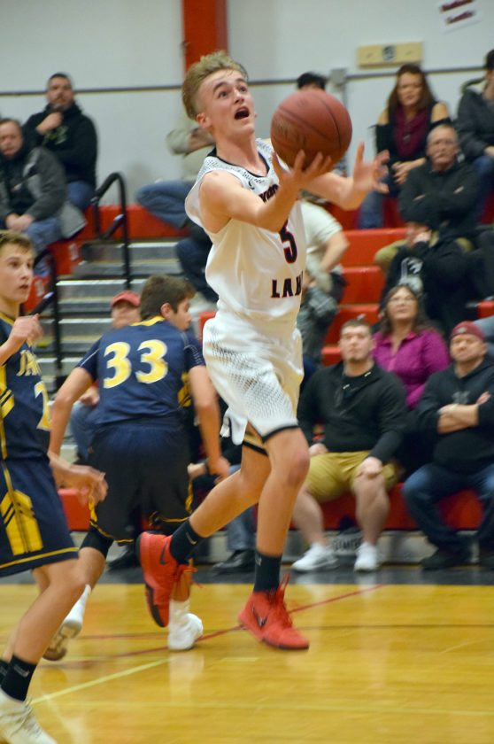 Tupper Lake junior Noah Cordes drives to the hoop during the first half of Monday's game against Madrid-Waddington. (Enterprise photo — Justin A. Levine)