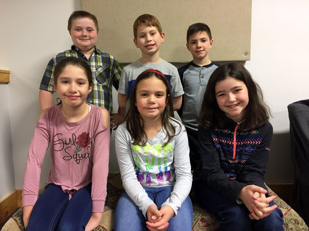 The Saranac Lake Winter Carnival 2018 pages are, seated in the front row from left, Ashlyn Tomszewski, Madison Wilcox and Lilly Zander; and in the back from left, Lucas Rogers, Trey Mariano and Brice Heery. Students in the Saranac Lake area are nominated by their third-grade teachers. Three girls' and three boys' names are selected randomly from that list. (Photo provided)