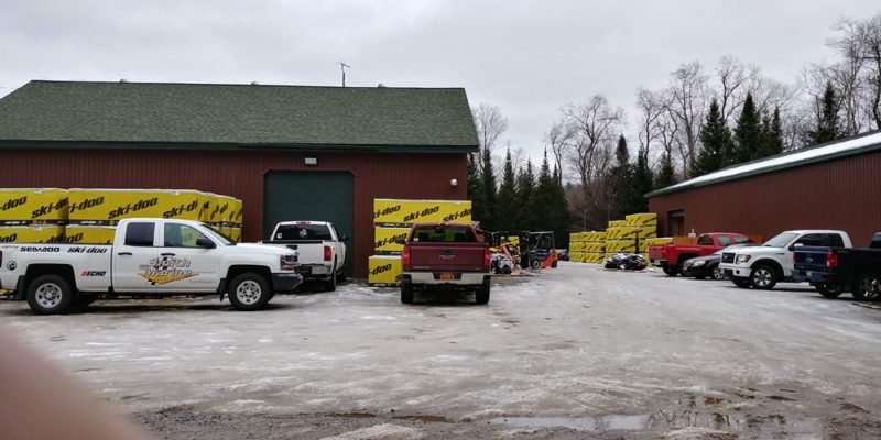 Snowmobiles are seen ready to sell in crates at Smith Marine in Old Forge. (Photo provided — Scott S. Thompson)