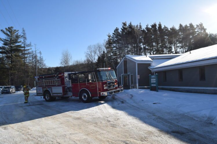 A Saranac Lake Volunteer Fire Department truck is parked outside the Physicians and Surgeons building Thursday morning. (Enterprise photo — Glynis Hart)