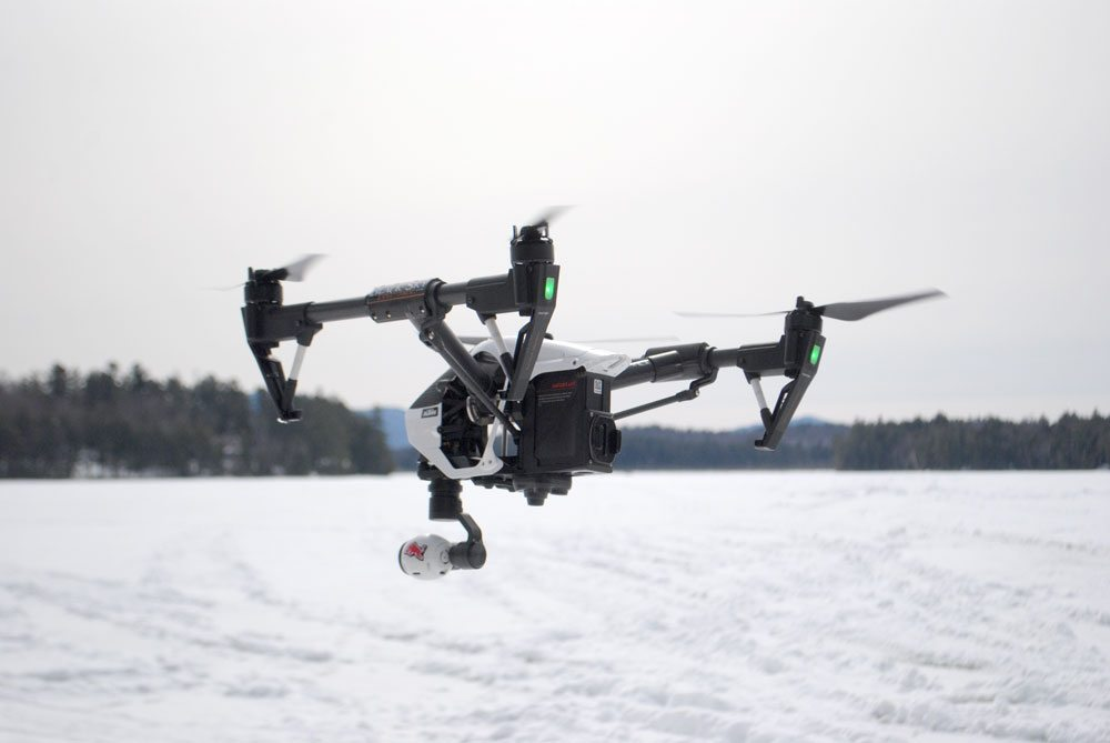 A drone, owned and piloted by Robin Johnson, hovers in March 2015 in Saranac Lake.  (Enterprise photo — Matthew Turner)