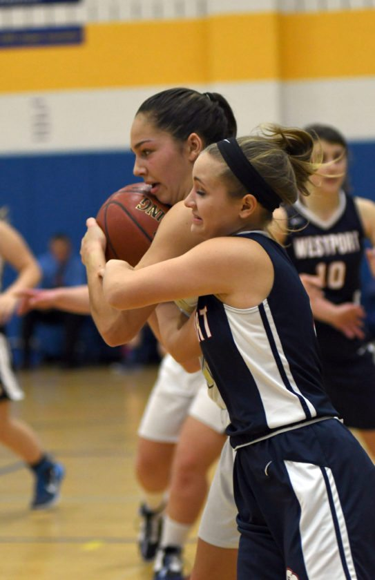 Lindsey Rath of Lake Placid rips the ball away from Westport's Maggy Ploufe during the second half. (Enterprise photo — Lou Reuter)
