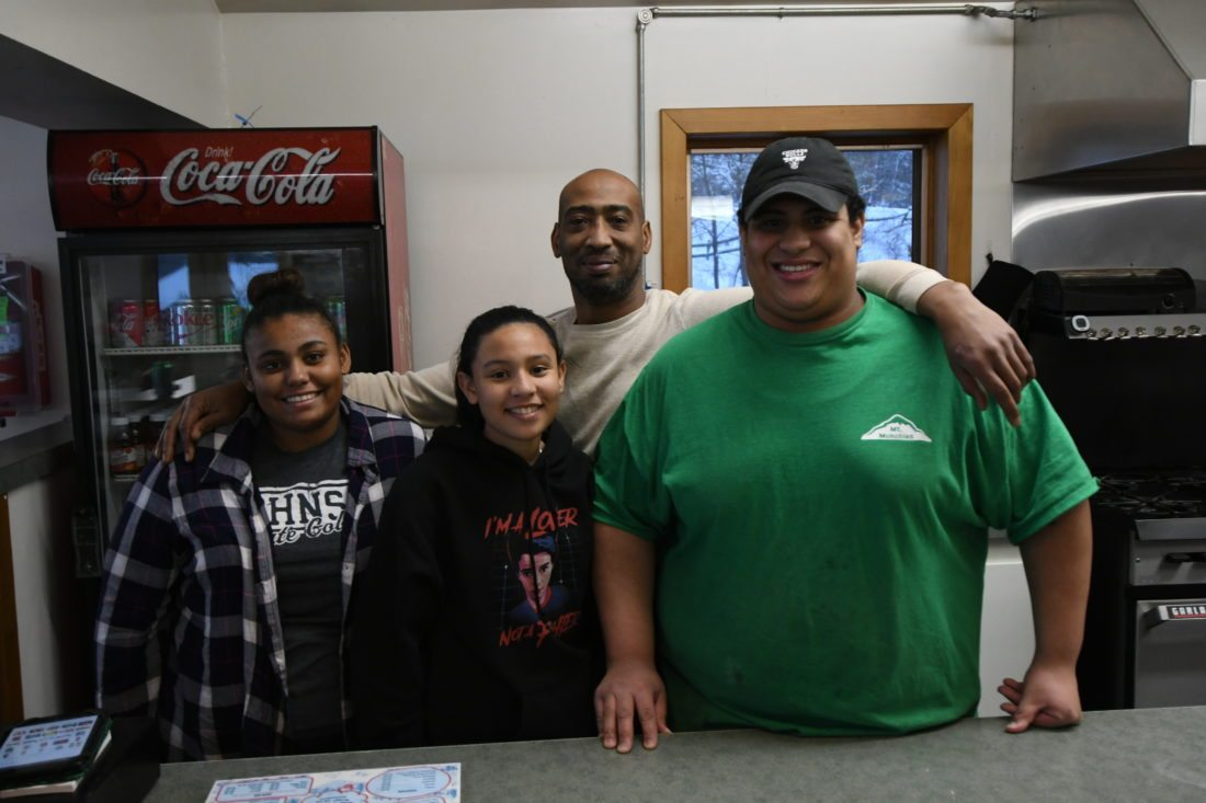 The concession crew of  Karina Williams, Angie Gonzalez, CJ Williams and Charles Williams smile from Mount Pisgah's lodge. (Enterprise photo — Lou Reuter)