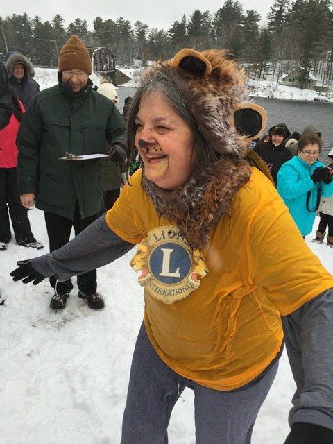 Barbara Taylor plunges as a Long Lake Lion as Judge Jim Bateman looks on. (Photo provided)