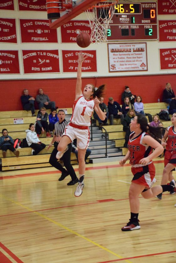Saranac Lake's Kylee Clark sends up a layup late in the first quarter of the Red Storm's home win over the Tupper Lake Lumberjacks. (Enterprise photo – Justin A. Levine)