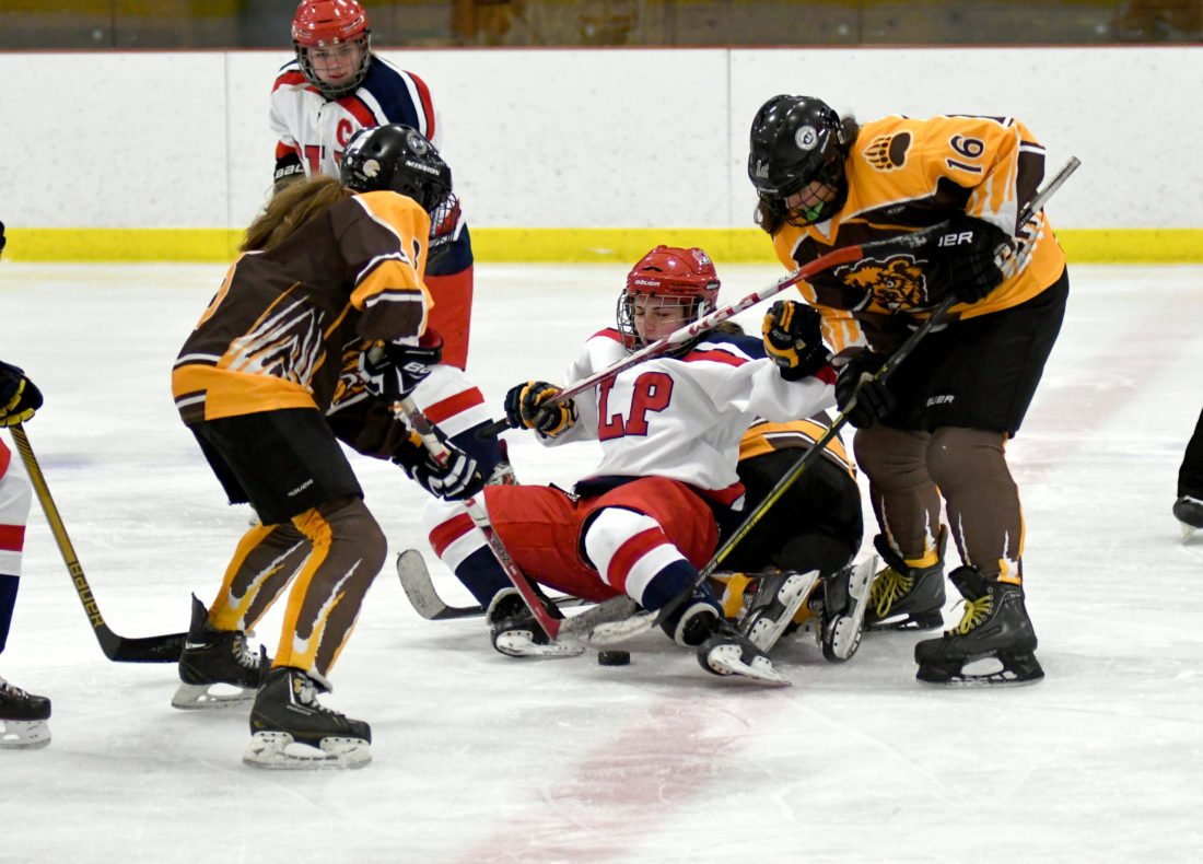 SLP's Karli Casler lands in a heap of Golden Bears while battling for the puck at center ice in Friday's game. (Enterprise photo — Lou Reuter)