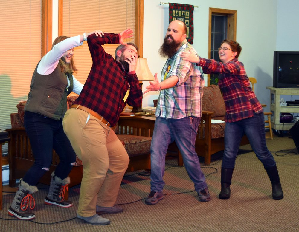 Merritt Billiter and Jason Borrie of Comedy Improv get some physical direction from audience volunteers Lena and Emma at the First Presbyterian Church for First Night Saranac Lake.  (Enterprise photo — Glynis Hart)
