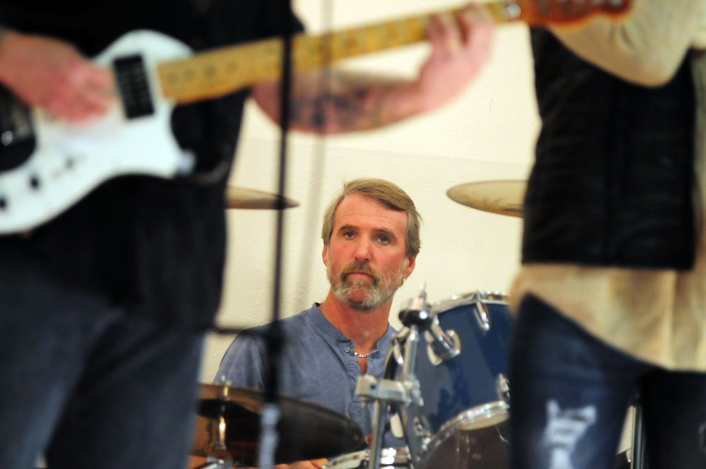 Tim Benway, drummer for Movin' On, plays with the country band Sunday night in the hall of the First United Methodist Church during First Night Saranac Lake. (Enterprise photo — Peter Crowley)