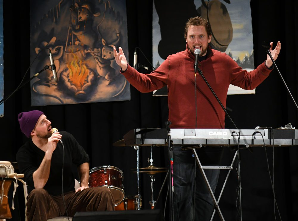 Stand-up comedian Owen Benjamin, right, and his brother Jason Smith, both of Saranac Lake, perform Sunday night at the Harrietstown Town Hall during First Night Saranac Lake. (Enterprise photo — Lou Reuter)
