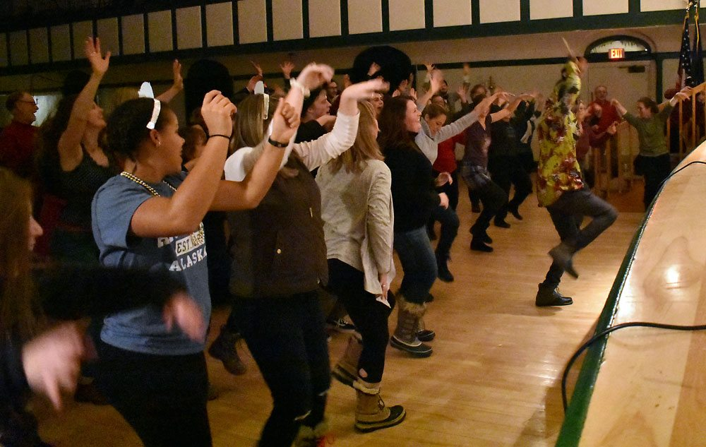 People dance to the music of Soulsha Sunday night at the Harrietstown Town Hall during First Night Saranac Lake. (Enterprise photo — Griffin Kelly)