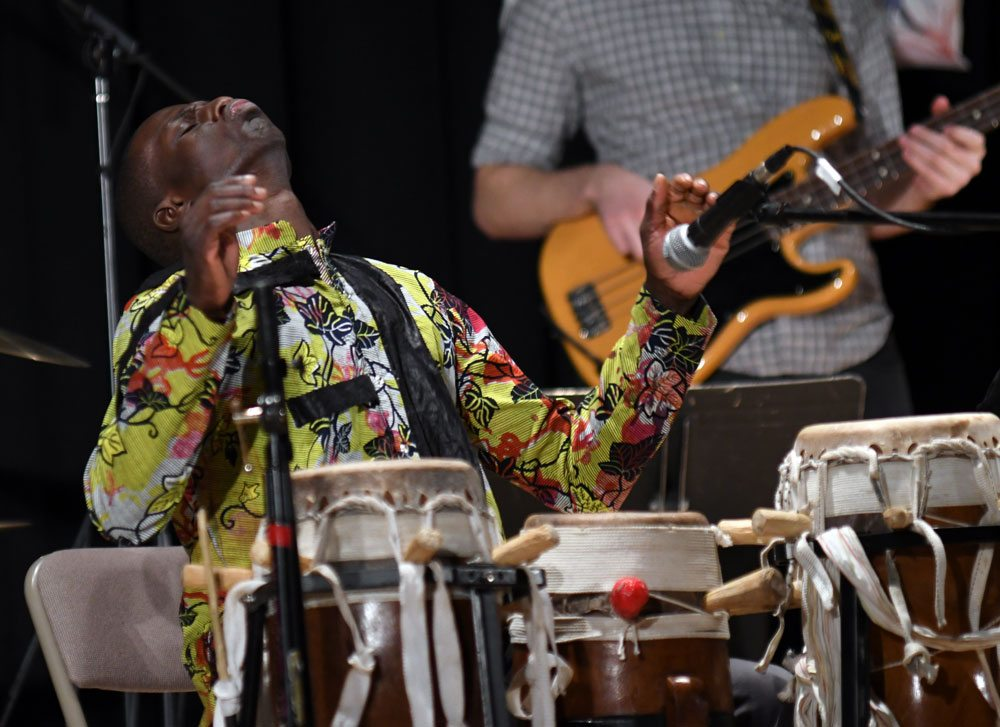 Sousha percussionist Malick Ngom gets into the rhythm Sunday night at the Harrietstown Town Hall during First Night Saranac Lake. (Enterprise photo — Lou Reuter) [Correction: An earlier version of this caption misidentified the percussionist.]