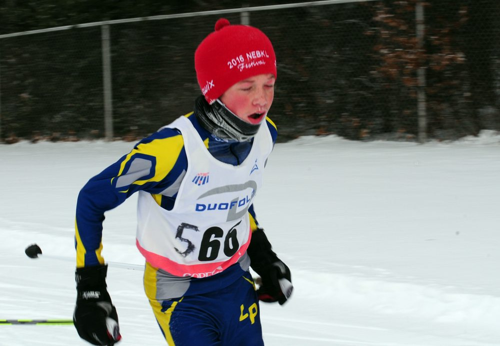 Lake Placid middle-schooler Max Flanigan endures the cold during Saturday's race in Queensbury. (Enterprise photo — Peter Crowley)